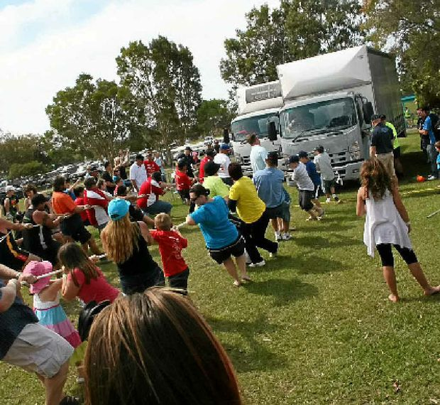FUN TIMES: At last year's Brisbane Convoy for Kids people tried their hands at truck pulling.