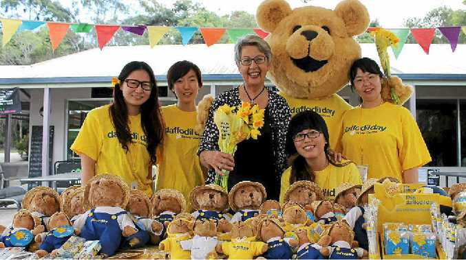 FLOWER POWER: Mayor Jenny Dowell with some of the volunteer sellers at SCU's Daffodil Day.