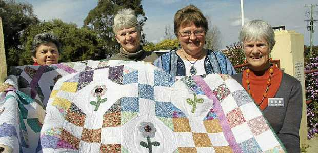 (From left) Goonellabah Quilters' Livia Perin, Colleen Smith, Carol Bonamy and Patricia Smithyman show one of the intricate crafts to be showcased at Lismore City Hall on September 6, 7 and 8. Three handmade pieces will be raffled and proceeds will go to the Lismore Base Hospital