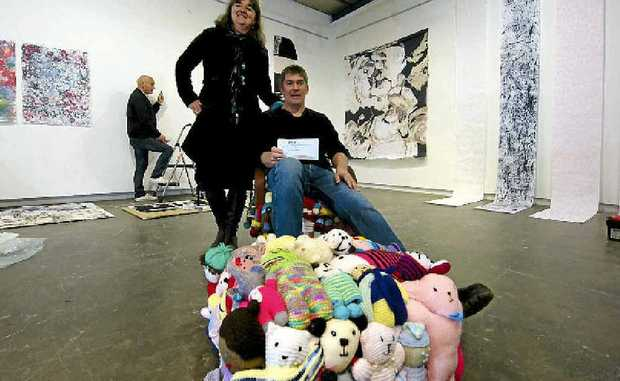 John Walters with his 3D installation of furniture made from soft toys.