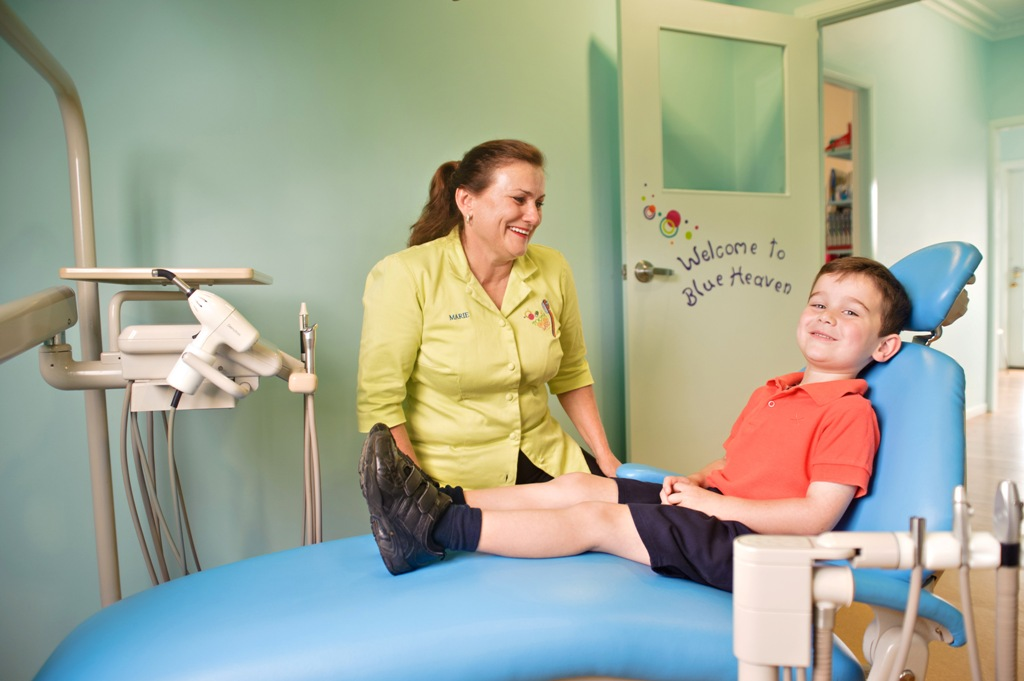 Toowoomba dental hygienist Marie McCormack makes Clarke Anderson feel comfortable before a quick check over.