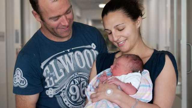 Baby Charlotte Mary and parents Dane Dixon and Rachel Kiani.