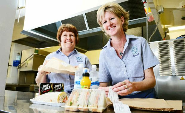 IGGS tuckshop catering assistants Janet Dern (left) and Natalie Curley prepare student lunches using an online ordering system.