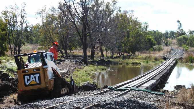 A crew works on the inspection of Capella Creek railway bridge last month.