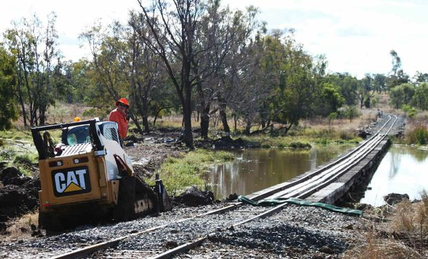 A crew works on the inspection of Capella Creek railway bridge last month.