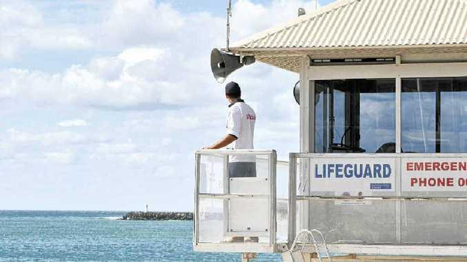 A Sunshine Coast Council Lifeguard keeps a watch over Mooloolaba Beach.