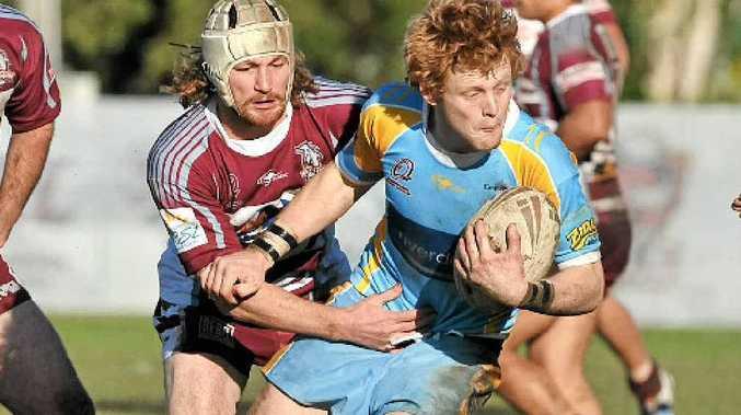 Gympie utility Ben Santowski takes on the Kawana defence last month.