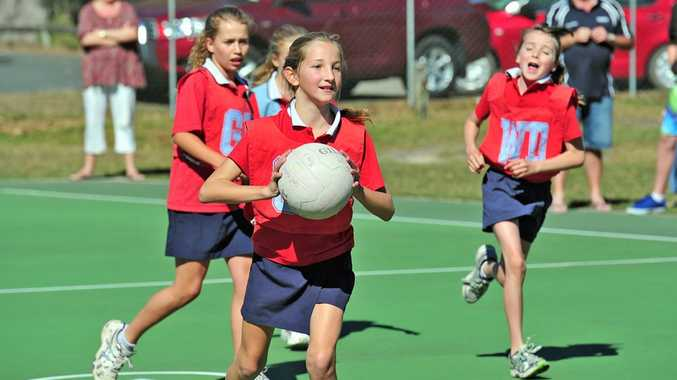 Noosa Netball Association. Grand Final Day Action. A St. Thomas More Sparks player in action. Photo Geoff Potter / Noosa News.