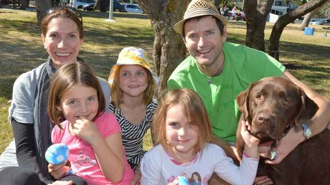 Robert and Christine Boeke with their children Keira, 7, Ava, 6, and Livia, 4, and Buddy.