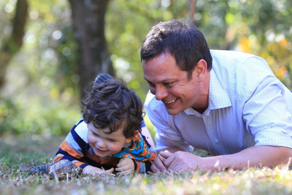 2-year-old Jackson Kelleher and his dad David take a close look at a blue tongue lizard at Australia Zoo.