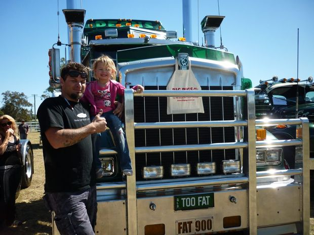 Sha'leigh and Alan 'Shiny' Miners stand in front of Too Fat a '93 Kenworth