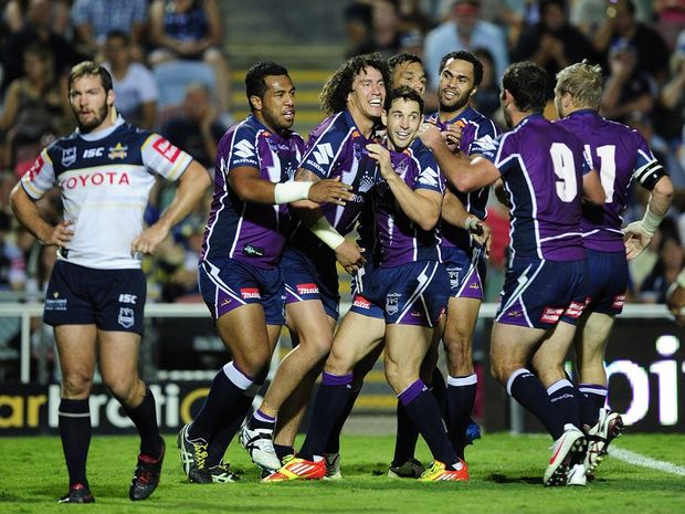 Kevin Proctor (third from left) of the Storm celebrates a try during the round six NRL match between the North Queensland Cowboys and the Melbourne Storm.