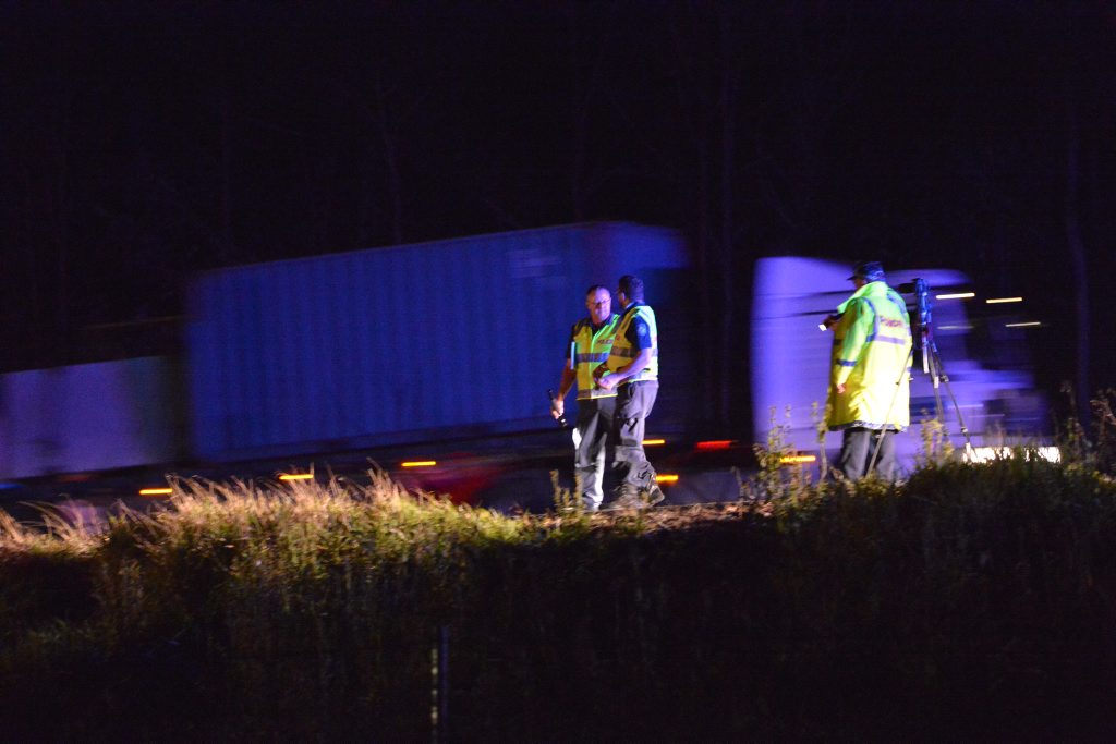 Police on the scene after a man was hit by a passing truck and killed on the Bruce Highway at Kulangoor.