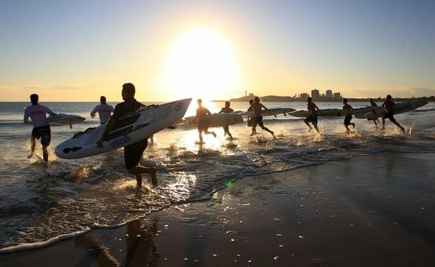 Sunshine Coast Life Guards join together on Mooloolaba beach for a meeting.