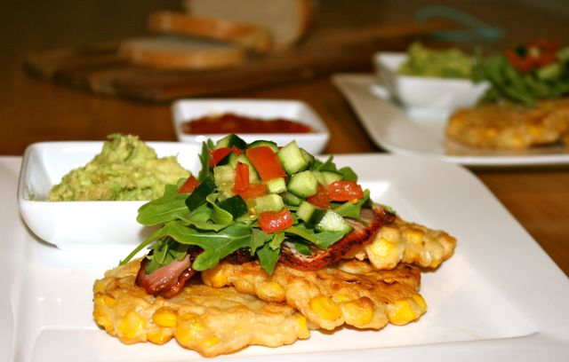 Miss Foodie's corn fritters with bacon, smashed avocado and salsa.