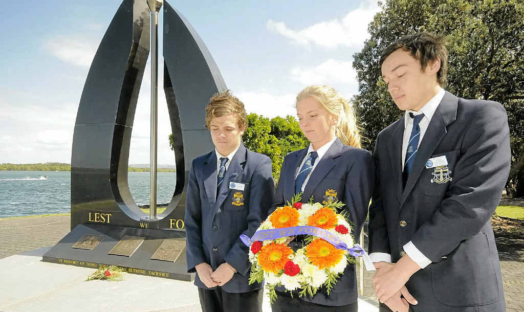 REFLECTION: Ballina High School students (from left) James Heath, Samie Jeffery and Ethan Halvorsen-Dunwoodie reflect after taking part in last Sunday's Legacy service in Ballina.