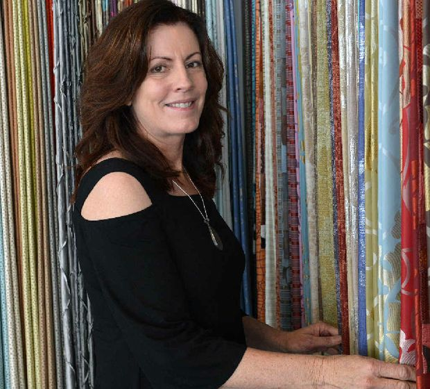 Robyn Jackson of Vision id Interior Design with some of her many fabric samples.