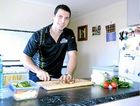 Hervey Bay Bombers player Brad Richards prepares lunch before heading to work.