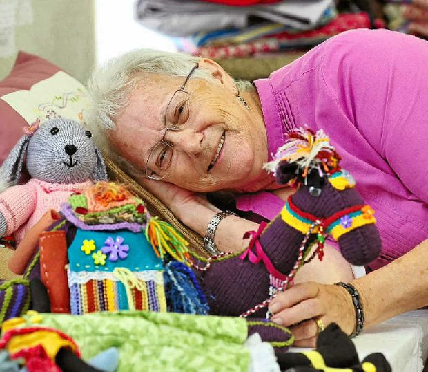 Judge Val Van Rijn gets down with soft toy entries featuring at the Noosa Show.