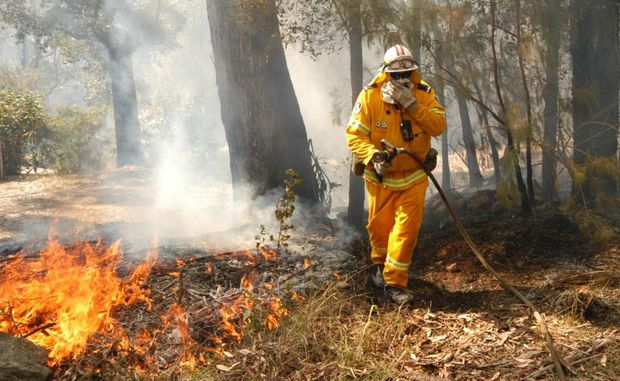 The Rural Fire Service battled a bushfire, which spread from the Nambucca State Forest, lept Deep Creek and made its way towards the Nambucca Industrial Estate on Friday afternoon.
