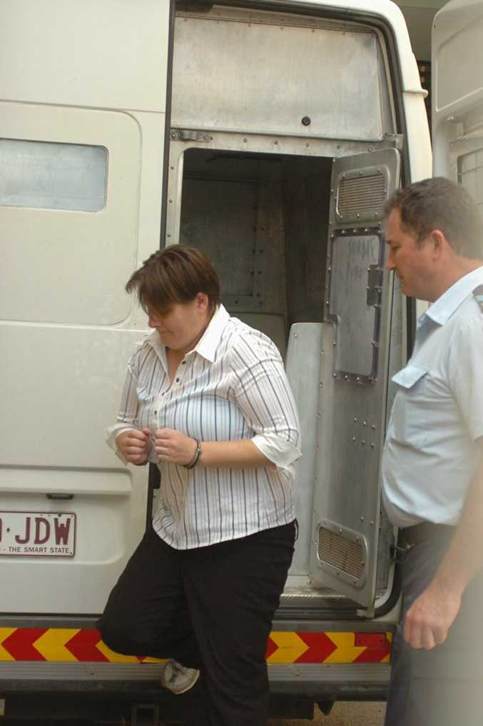 Dianna Gay Wright arrives at the Maryborough Courthouse in police custody.