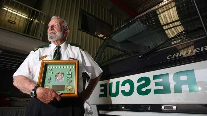 Mo Sullivan with a framed tribute to former rescue volunteer, the late Bob Counter.