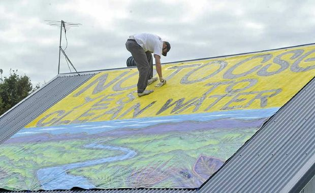Giant protest sign against CSG painted by Julla Livingston.