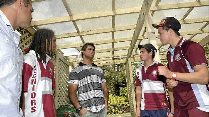 Sid Domic, left, and Matt Sing discussing football with current North Rockhampton State High School students Trey Butler, Jerron Wagg and Leithen Goltz.