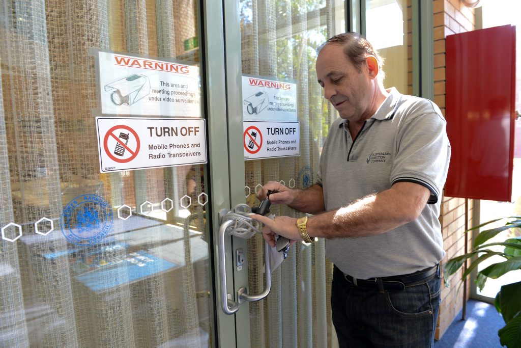 election Returning officer Paul Wittman locks the coffs harbour council chambers to secure ballot papers awaiting a final preference count. Photo: Trevor Veale