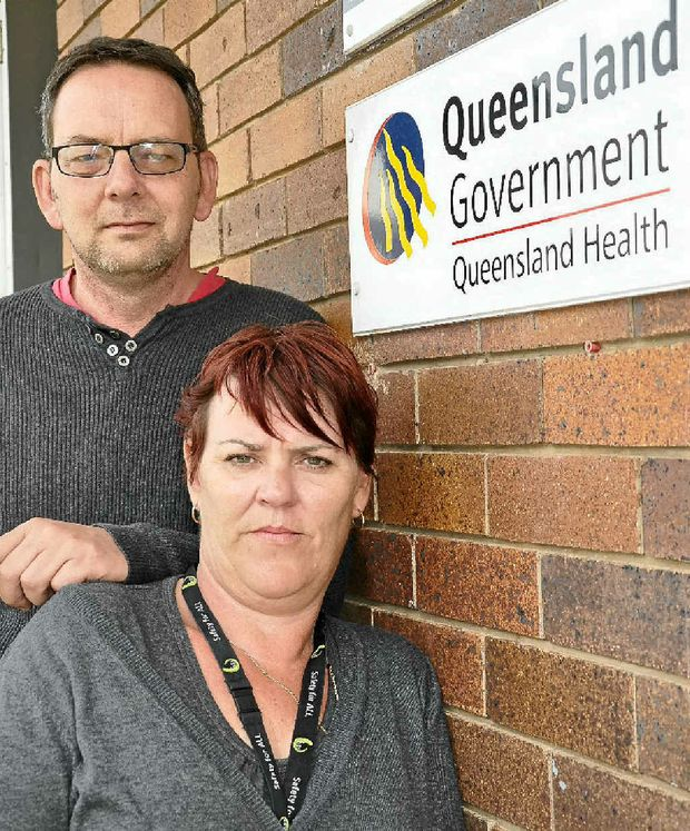 Together Union delegate Craig Nelson with Queensland Health worker Elizabeth Handley who was made redundant on Friday.