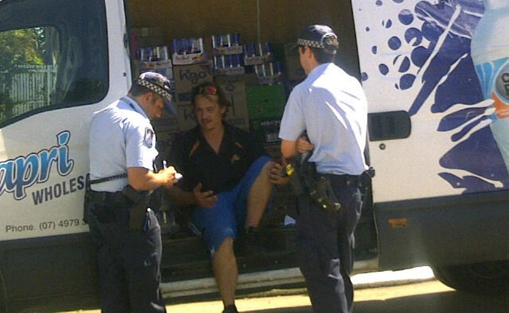 Police speak with the victim of an alleged hold-up at a Rockhampton service station.