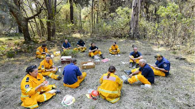 Members of the Byron Bay, Mullumbimby and Wollongbar Rural Fire Service crew pause for some lunch after controlling fires in the Candole State Forest.