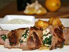 Stuffed lamb loin with lemon potatoes and tzatziki.