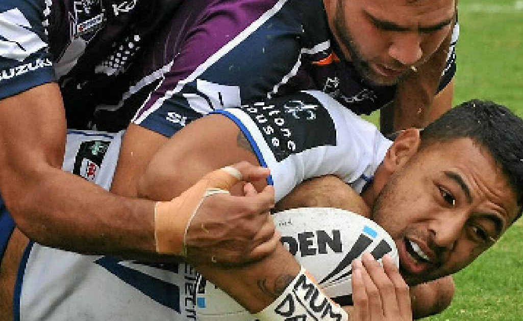 Storm's Cam Smith tackles Krisnan Inu at Virgin Australia Stadium.