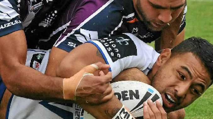 Storm's Cam Smith tackles Krisnan Inu at Virgin Australia Stadium.