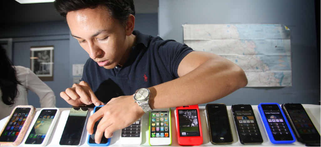 Michael Strickland checks out a selection of iPhones which will be superseded by iPhone5 in the coming weeks.