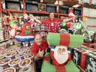 Bunnings Maroochydore employees Gary Farrugia, left, and Ryan Martin get to work setting up their Christmas light display.