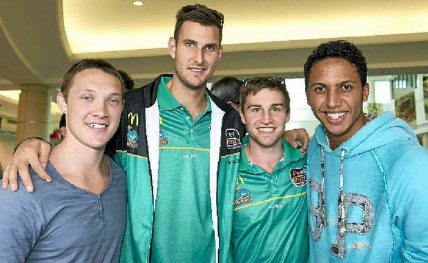 Matthew Ebneter (left) and Charles Dickerson (right) meet their new teammates for the week, Townsville Crocs players Ben Allen and Mitch Norton.