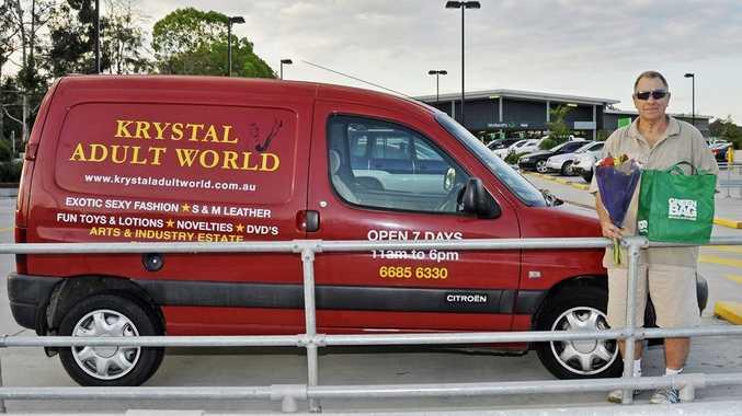 Stephen Keen next to his van advertising his adult business.