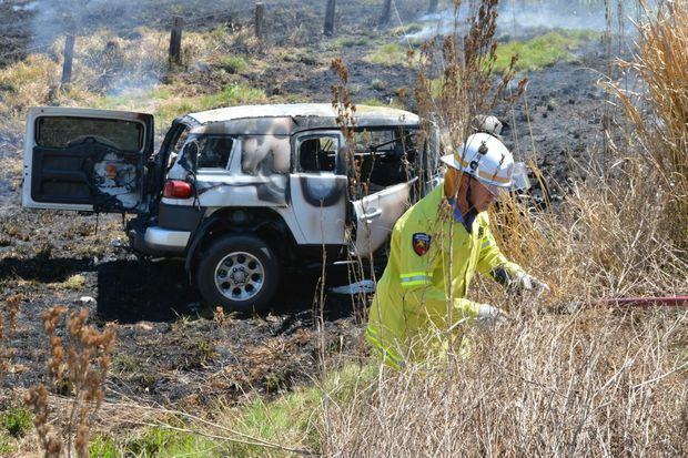 Two four-wheel-drives collided head on and sparked a fire just north of Gympie.
