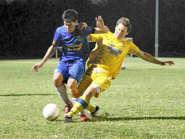 Noosa right-back Percey Cash is tackled late by Kawana's Scott Rocker during the preliminary final.