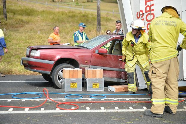 Emergency services at scene of a serious accident between a car and semi-trailer on the Bruce Highway, south of Gympie.