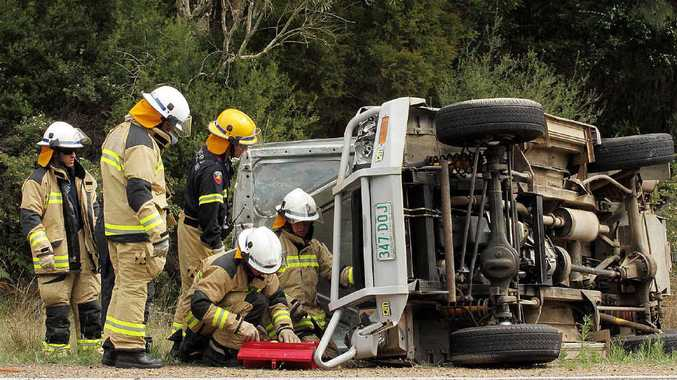 Emergency Service crews attend a single-vehicle rollover on Burrum Heads Rd.