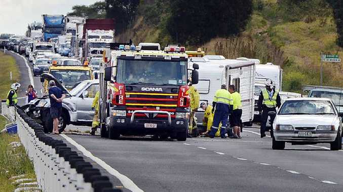 Emergency Services at a crash involving a jackknifed four-wheel drive and caravan near Marburg.