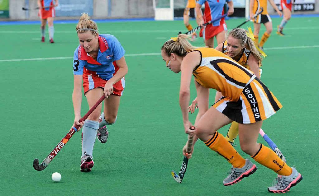 Jodie Dwyer moves to get past Southside defenders Andrea Farrow (back) and Jordan Edwards in the Women's A-grade hockey grand final on Saturday.