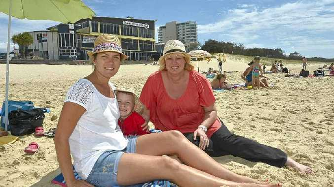 Megan and Angus Dougherty with Helen Rhule at Maroochydore Beach.
