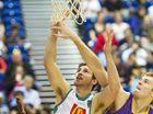Crocs point guard Mitch Norton nails a shot under pressure from Sydney's Tom Garlepp.