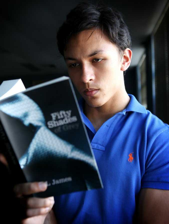 Student Michael Strickland reading popular erotic novel Fifty Shades of Grey.