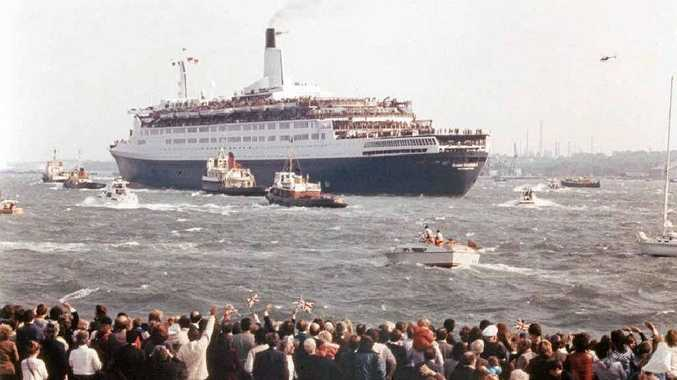 QE2 steams out of Southampton for the Falklands cheered on by well-wishers.