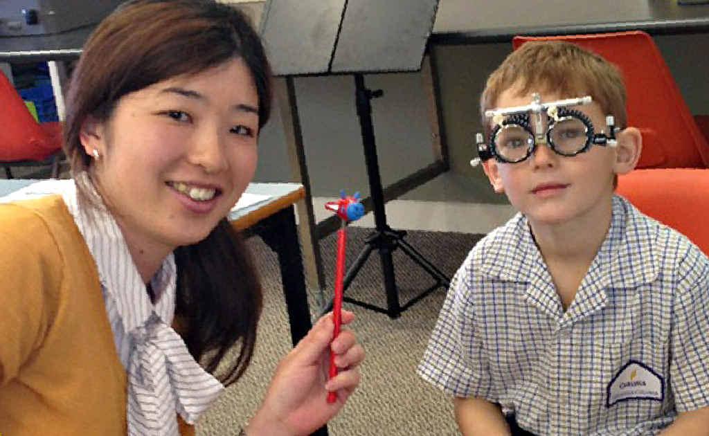 Westfund Mackay Optometrist Hiromi Yoshikawa tests Sam Palmer's vision.